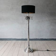Crafted from aluminium, the lamp base features intricate detailing drawing strong resemblance to a palm tree. Tree Floor Lamp, Tree Lamp, Floor Lamps, Palm Tree Lights, Palm Trees, Gold Lamp Shades, Ikat Print, Lamp Bases, Lamp Design