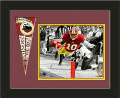 One framed 8 x 10 inch Washington Redskins photo of Robert Griffin with a Washington Redskins mini pennant, double matted in team colors to 14 x 11 inches.  (Pennant design subject to change)  $59.99 @ ArtandMore.com
