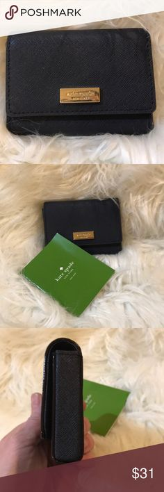 Brand New Kate Spade Blue card wallet Re-posh! Bought this on Poshmark for my mother-in-law for Christmas and unfortunately it was the wrong one. So my loss is someone else's gain. All reasonable offers will be considered trade offers welcome! Free gift with every purchase. kate spade Bags Wallets