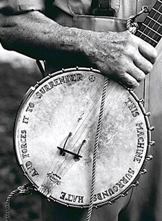 "I saw this photo of Pete Seeger's banjo at the San Diego MOPA and I've never forgotten it. The text reads ""This machine surrounds hate and forces it to surrender""."