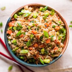 Kick up your fried rice game.. Ingredients: For the rice:, 2 tbsp. sesame oil, divided, 1 lg. head cauliflower, 2 carrots, finely diced, 1 cup frozen edamame, 2 cloves garlic, minced, 5 stalks chopped green onion, For the sauce:, 3 tbsp. coconut aminos, 1 tbsp. peanut butter, 1 tsp. chili paste