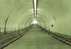 Washburn Tunnel - a two-lane underwater motor-vehicle tunnel connecting Galena Park and Pasadena, two suburbs of Houston, Texas. Completed in 1950, it travels north-south underneath the Houston Ship Channel.