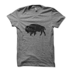 """This incredibly soft shirt is hand-screened and features our minimalist bison.  This animal is part of our cultural heritage should be worn proudly!Part of our """"Heritage"""" collectionHand-printed on American Apparel tri-blend style t-shirt - (50�0Polyester / 25�0Cotton / 25�0Rayon)"""