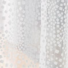 <p><span>An all-over pattern of tiny squares resembling confetti.</span></p>