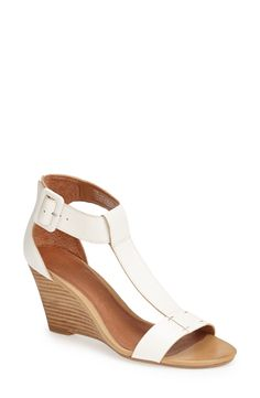 Nice! Love the simplicity of these white T-strap sandals. Will pair well with a cute summer dress or romper.