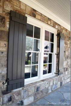 Feature Friday: Update on the Atlanta House Rebuilt - Southern Hospitality Black shutters, shutter dogs, stone, white trim, porch ceiling. Window Shutters Exterior, Black Shutters, Wood Shutters, Houses With Shutters, Windows With Shutters, Outside Shutters, Cottage Shutters, Outdoor Shutters, Farmhouse Shutters