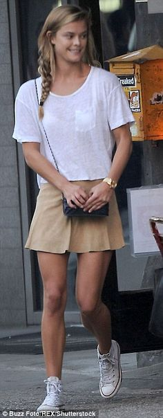 Nina Agdal enjoys a cheeky smoke as she shows off her legs in a cream mini skirt while headed to dinner in NYC | Daily Mail Online