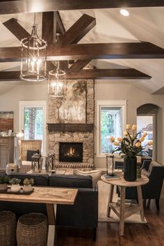 Transitional Living Room with High ceiling, metal fireplace, Carpet, Pendant light, Exposed beam, Hardwood floors