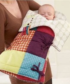 Jamboree Snuggle Me - it's like a sleeping bag for babies that unrolls into a traveling play mat. Great for keeping babies warm and from rolling around when away from home