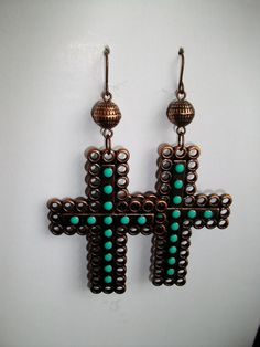 Hey, I found this really awesome Etsy listing at http://www.etsy.com/listing/109847662/copper-turquoise-cross-earrings