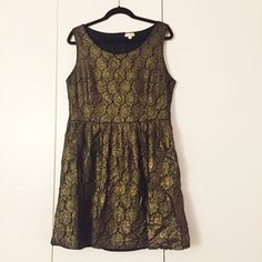 Black and gold flower-pattern dress Subtle black and gold flower pattern with an A-line cut. Only worn once and in excellent condition! 72% cotton, 28% nylon. Maison Jules Dresses Mini
