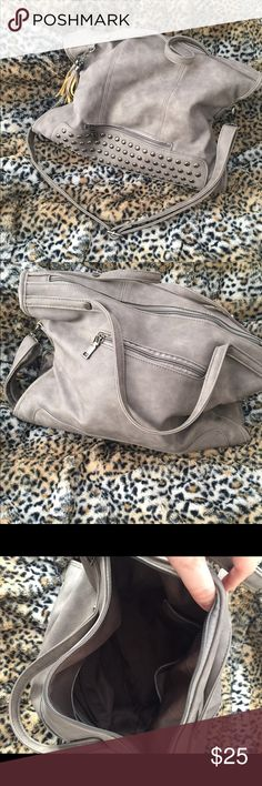 Super cute gray handbag Great condition, only used it for a week before I switched to another handbag. No discoloration, stains or tears anywhere. Great for fall and winter months. Bags