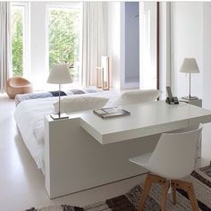 Clever little dressing table / study nook in this white on white bedroom. Regram via @lucdesign #thedesignhunter #bedroom #bed #study #studynook #office #dressingtable #chair #white #interiors #design #decorating