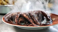 Freshly cooked octopus ready for slicing - via Bizarre Foods: Lisbon, Portugal | Andrew Zimmern traveled to Lisbon, Portugal, to check out its impressive food scene. Go behind the scenes with Andrew to get his take on the food, people and amazing culture of Lisbon.