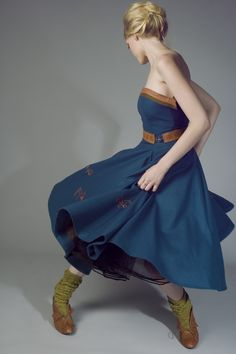 Sami inspired fashion;  Blue wool dress with reindeer leather belt