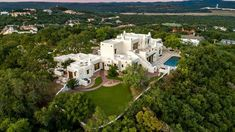 Bird's Eye View | See inside the incredible Sante Fe-inspired home. If you're in the market for a spectacular San Antonio estate, George Strait may have listed the home of your dreams. King George put up his otherworldly home last week, created out of imported adobe and sitting on 12.2 quiet acres. The 7,925-square-foot home features three bedrooms, four full baths, and two half-baths along with 14 fireplaces, an infinity-edge pool, and ample space for outdoor entertaining.