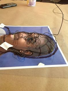 Good technique for wire portrait sculptures, or draw over face on transparency to make a monoprint...