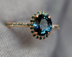 Peacock sapphire oval halo blue green diamond ring Rose gold ring by Eidelprecious gold Weddings Blue Green sapphire engagement ring. Peacock sapphire oval halo blue green diamond ring Rose gold ring by Eidelprecious Green Sapphire Engagement Ring, Green Diamond Rings, Gold Engagement Rings, Halo Engagement, Gold Rings, Green Sapphire Ring, Green Rings, Ceylon Sapphire, Engagement Rings With Sapphires