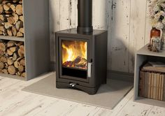 The EVOLUTION 5 DELUXE multifuel stove has a distinctive and stylish feature of a glass top.