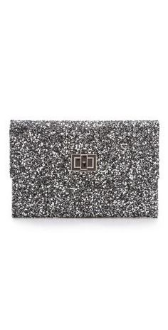 Add a little sparkle to your life with this adorable Anya Hindmarch Valorie Glitter Clutch.