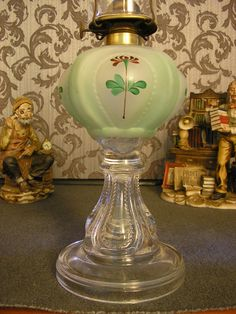 Antique Serrated Loop oil lamp hand painted in green tones