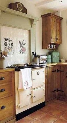 Warm, rustic kitchen with vintage stove. Art Deco Kitchen, Kitchen Redo, Rustic Kitchen, Kitchen Design, Cottage Kitchens, Country Kitchens, Home Kitchens, Country Interior, Home Interior Design