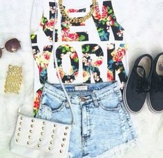 Light denim high waisted shorts, White printed with black and color muscle tank, Black shoes, Crossbody bag, Edgy necklace