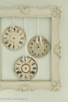 I love this look but i would use a black distressed frame and twine to hang the clocks on