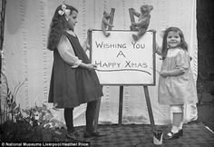 Festive message: The girls wish everyone a Merry Christmas, the Edwardian way.