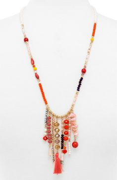Free shipping and returns on BaubleBar 'Congo' Beaded Tassel Necklace at Nordstrom.com. Beautifully beaded fringe strung with mismatched beads and a bright tassel for good measure adds whimsy and movement to a long layering necklace with worldly appeal.