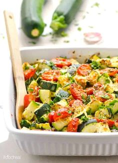 Healthy Zucchini Squash Tomato Bake Recipe is a 5 minute prep low carb zucchini tomato casserole with dried herbs and Parmesan cheese. Serve as a side or add cooked chicken for a 30 minute dinner.