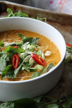 Spicy Thai Curry Noodle Soup Produce 1 	Cilantro, Fresh 3 	Garlic cloves 2 tbsp 	Ginger, fresh Canned Goods 4 cups 	Chicken broth 3 cups 	Coconut milk 2 tbsp 	Red curry paste Pasta & Grains 6 3/4 oz 	Rice Oils & Vinegars 2 tbsp 	Coconut oil