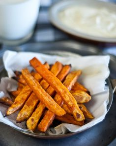 Savory Sweet Potato Fries-They are easy and fast to make and go with a lot of different meals from WellnessMama.com #recipes #fries #wellnessmama