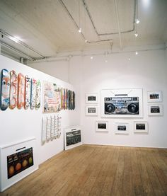 Contemporary Retail Store Design - Skateboard and boombox art hung on white walls in a gallery