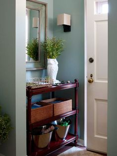 Think small and incorporate a narrow console table like the one shown here. fill the shelves with decorative storage baskets and Wooden Shelving Units, Shelves, Foyers, Entryway Storage, Storage Baskets, Entryway Ideas, Entry Organization, Organized Entryway, Organizing