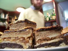 "Flódni (""FLODE-NEE"") is a traditional Jewish dessert popular in Hungary and consisting of layers of ground walnut paste, poppy seeds and apples spread between thin layers of pastry."