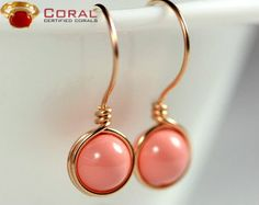 These coral embedded gold earrings will add sparkle to your outfit and efficiently portray your Style.
