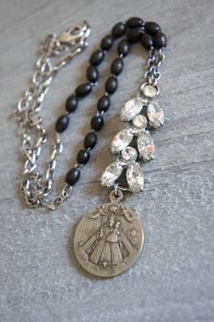Vintage medal, rhinestone link and rosary bead necklace by frenchfeatherdesigns.