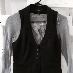 Black Vest H & M black vest. True to size. Adjustable strap on the back. Good condition. Wear with a cute lace top and maxi skirt:) Be creative! If your a waitress or barista, this is the vest to wear, I swear:) H&M Other