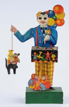Lot # : 871 - German Tin Wind-up Balloon Vender Toy.