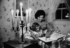 Jackie Kennedy reads to daughter Caroline, Hyannis Port, 1960. Alfred Eisenstaedt—The LIFE Picture Collection/Getty I
