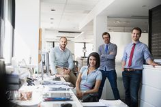 Portrait confident business people in office by Hero Images  - Photo 117292813 - 500px