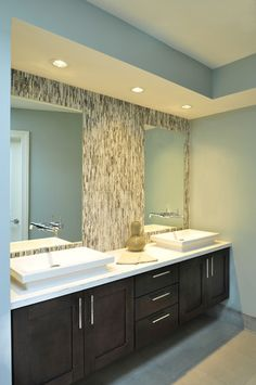 Ann Sacks glass mosaic tile running vertical.  Azure collection and the pattern name is Twiggy. Faucets mounted on mirror.