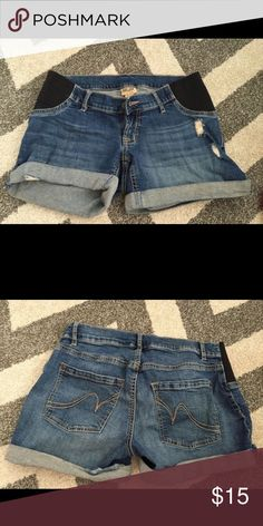 Maternity shorts Size XS fits size 5-7.  Under belly fit with elastic sides.  Cute distressed look Motherhood Maternity Shorts Jean Shorts