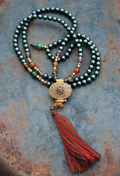 Mala made of 108, 8 mm - 0.315 inch, very special Teal Shell Pearls and decorated with faceted Agate, faceted Cherry Quartz and a Nepalese gold plated Ghau (Gau) box pendant - Made by look4treasures
