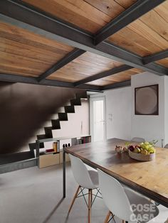 black beams on wood. Concrete floor.