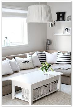 Love the baskets under the coffee table, sectional, and shelves. Too light though...needs some color!