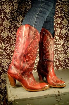 so desperately want a pair of real leather cowboy boots, instead of my cheap things .. having red ones would only be better.