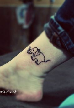 a cute little elephant tattoo with its nose blowing water #elephant #tattoo by gayle