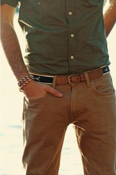 Rock an army green button-down shirt with khaki chinos for a casual level of dress.  Shop this look for $93:  http://lookastic.com/men/looks/olive-longsleeve-shirt-and-brown-leather-belt-and-tan-chinos/118  — Olive Longsleeve Shirt  — Brown Leather Belt  — Khaki Chinos